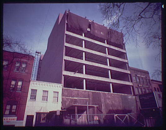 Miscellaneous building exteriors. Office building under construction, side angle