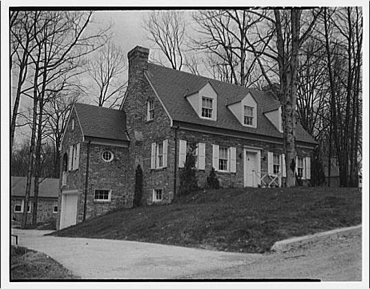 Miscellaneous houses. Exterior view of brick Colonial style house with garage on left