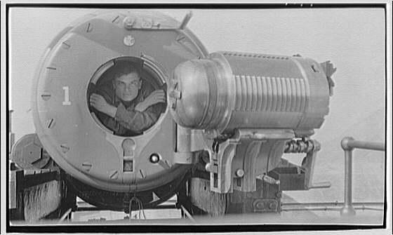 "Miscellaneous subjects. Theodor Horydczak in gun breach of 12"" C.A.C. Barbatt carriage gun at Fort Baker, California"