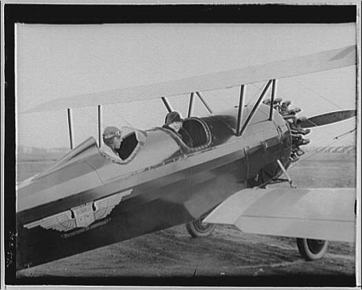 Mrs. Goff at the airport. Mrs. Goff in two-seater bi-plane II