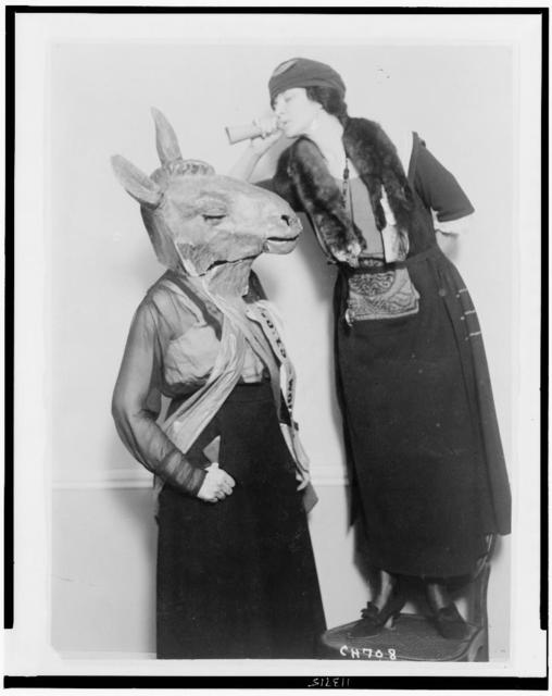 [Mrs. Guilford Dudley of Nashville with ear trumpet, talking into ear of Democratic donkey, played by Mrs. Mary Semple Scott in skit at 1920 National American Woman Suffrage Association in Chicago]