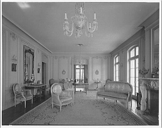Mrs. Moran home at 2320 Bancroft. View past chandelier to chairs and couch in Mrs. Moran's home