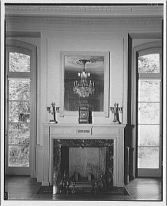 Mrs. Moran home at 2320 Bancroft. View to fireplace in Mrs. Moran's home, with chandelier reflected in mirror