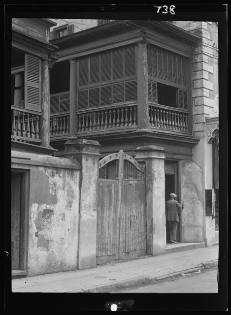 Multi-story house behind gated wall, New Orleans or Charleston, South Carolina