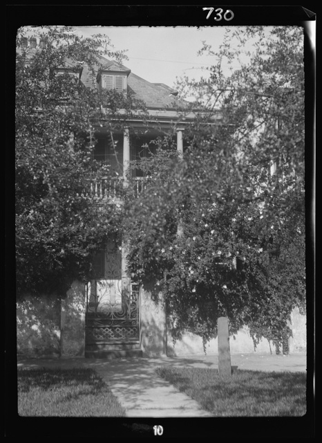 Multi-story house behind trees, New Orleans or Charleston, South Carolina