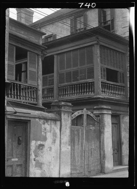 Multi-story house behind wall with gate, New Orleans or Charleston, South Carolina