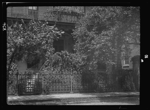 Multi-story house behind wrought iron fence, New Orleans or Charleston, South Carolina