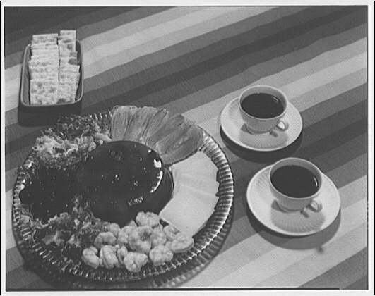 National Canners Association. Hors d'oevres and crackers with two cups of coffee I