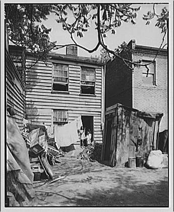 Nation's Business. Negro housing, toilets backyard I