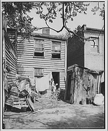 Nation's Business. Negro housing, toilets backyard II