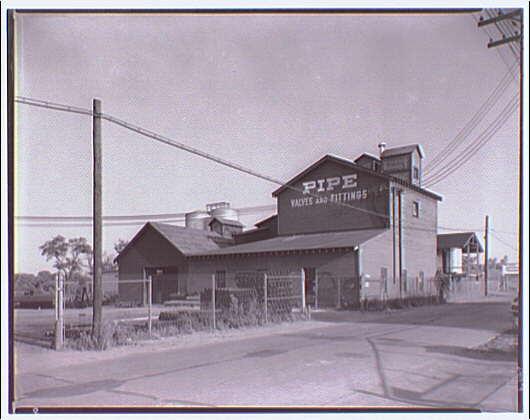 Noland Plumbing Co., Inc. Noland frame building in Rosslyn, Virginia I
