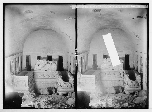 Palmyra. Tomb of the three brothers. Right hand chamber showing sarcophagi, loculi and portrait and group carvings