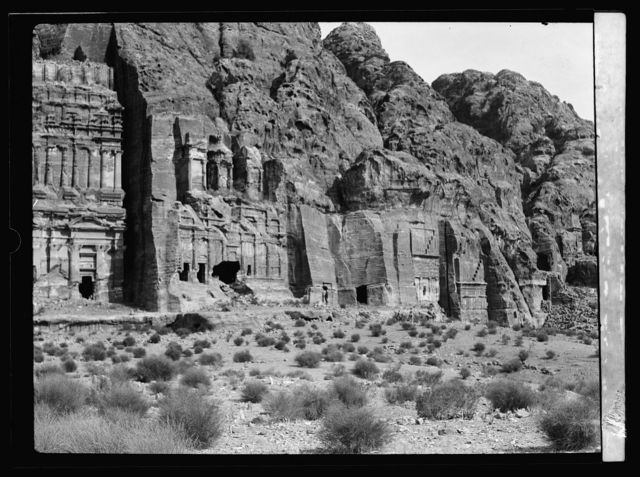 "Petra. Theatre and el-Khubta area. Facade of el-Khubta range showing the large ""Corinthian"" monument and smaller Nabtean tombs"