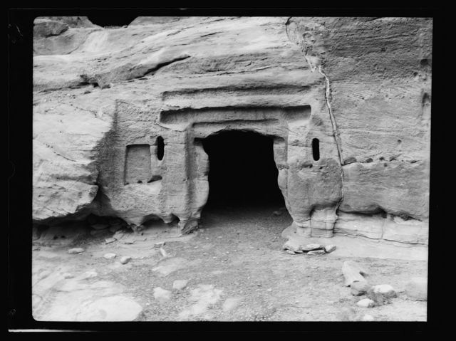 Petra. Wadi-Ed-Dêr. Early type rectilinear tomb with idol niche to left of door