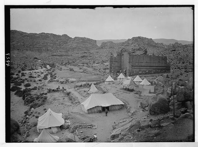 Petra (Wadi Musa). El-Habis area. Qasr Bint Far'on. A Roman temple; the only masonry monument left in Petra. Cook's camp in foreground