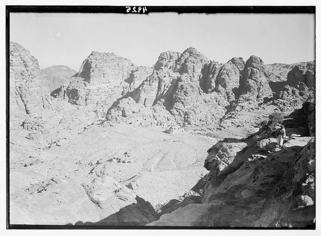 Petra (Wadi Musa). El-Habis area. The acropolis hill from high place of sacrifice, showing Qasr el-Bint and high mountain peaks across es-Siyyagh