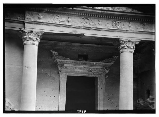 Petra (Wadi Musa). El-Khazneh. Elaborate consoled cornice. Above lintel of main doorway