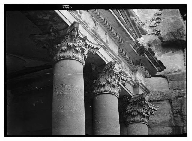Petra (Wadi Musa). El-Khazneh. The capitals of the portico. Telephoto showing intricate details