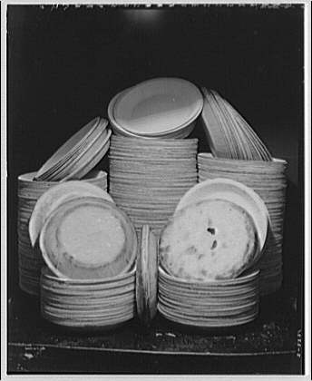 Pies and paper pie plates. Group of pies and plates