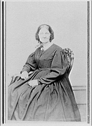 Portrait photographs. Copy photograph of woman in nineteenth-century dress seated in chair