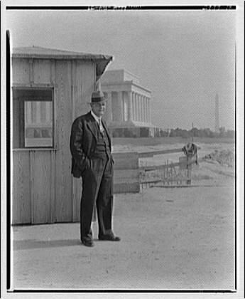 Portrait photographs. Man standing in front of shed near Lincoln Memorial