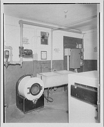 Potomac Electric Power Co. apartments and kitchens. Laundry room