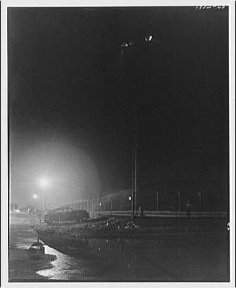 Potomac Electric Power Co. Buzzard Point plant. Coal pile at night at Buzzard Point plant