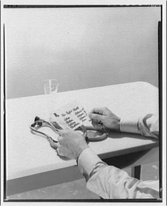Potomac Electric Power Co. electric appliances. Dr. Hands with card of balanced food