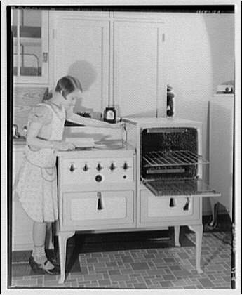 Potomac Electric Power Co. electric appliances. Norma at electric range I