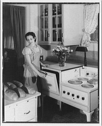 Potomac Electric Power Co. electric appliances. Smiling model baking bread I