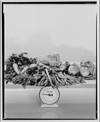 Potomac Electric Power Co. electric appliances. Vegetables on scale, 19 lbs.