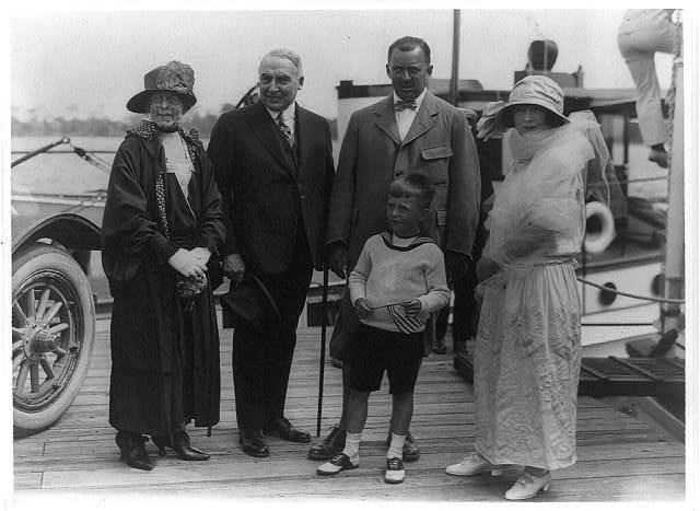 [President and Mrs. Harding with Mr. and Mrs. Edward Beale McLean and son, standing on a pier in Palm Beach, Fla.]