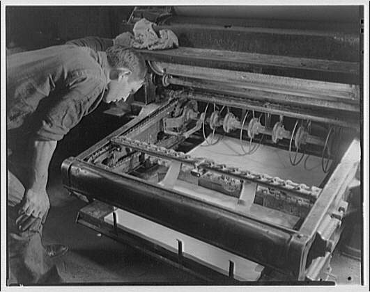 Printing shops in Washington for Stanford Paper Co. Man working at printing press II