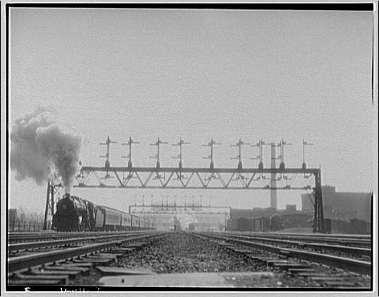 Railroad views in rear of Union Station. Train approaching Union Station on left track