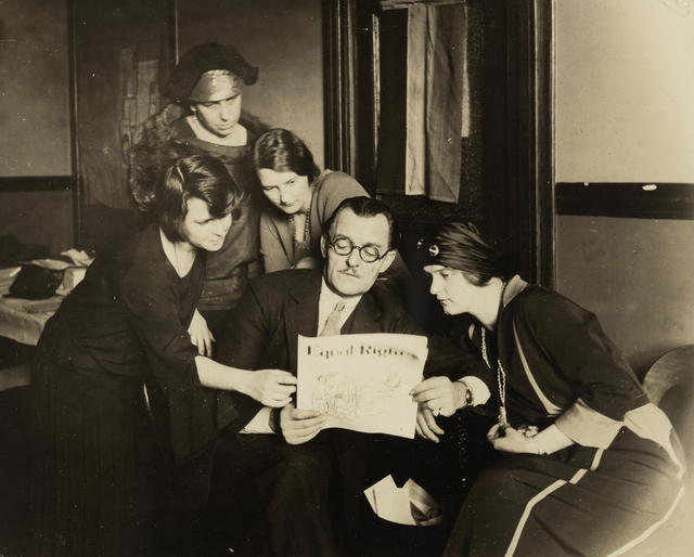 """Richard Bennett, noted actor, calling at National Woman's Party Headquarters, underwrites the Equal Rights campaign, and declares: - """"Certainly I am a feminist and will stand back of you women until the Equal Rights Amendment is passed by Congress."""" Mr. Bennett is surrounded by a group of National Woman's Party leaders. (Left to right) Anita Pollitzer, National Secretary of the Woman's Party, Richard Bennett, Wilma Henderson, National Organizer: (upper left) Mrs. Everett Bray, a Founder, and Jessica D. Henerson, member of the Massachusetts State Committee."""
