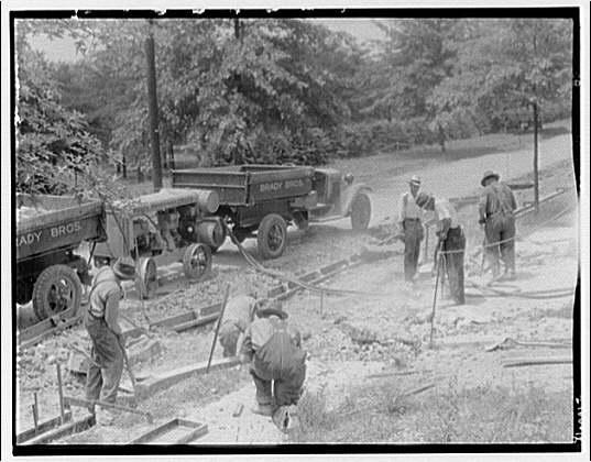 Road construction site. Men making curbs I