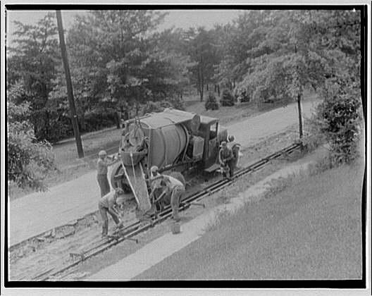 Road construction site. Men making curbs II