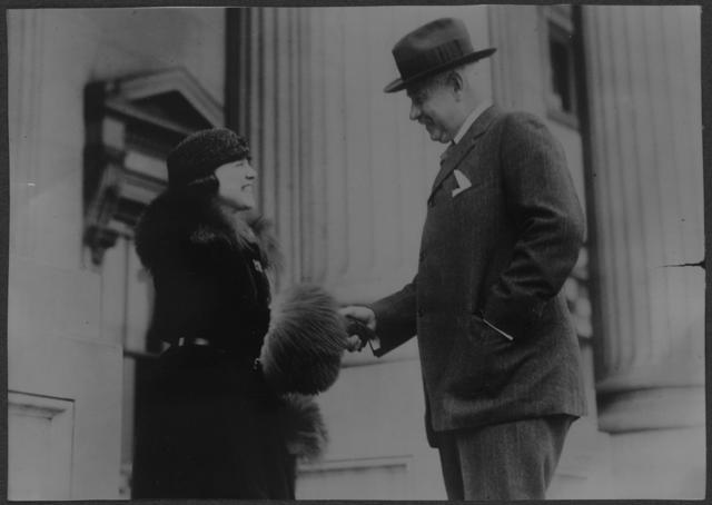 Senator Freylinghuysen congratulates Betty Gram on New Jersey's ratification, Feb. 1920.
