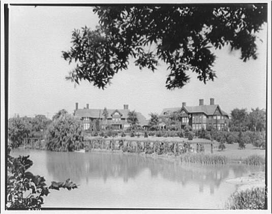 Shaker Heights, Ohio. View across lake to house in Shaker