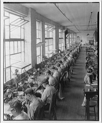 Sheaffer fountain pen factory, Ft. Madison, Iowa. Line of nib grinders and their operators