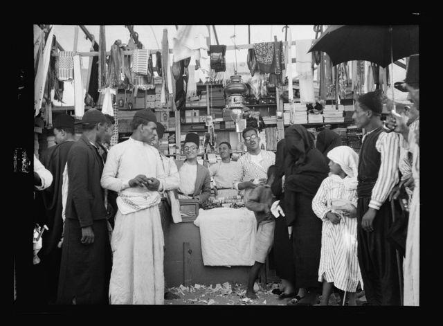 Southern Palestine. Nebi Rubin (The Prophet Reuben). A Nebi Rubin store. A typical dry goods stall