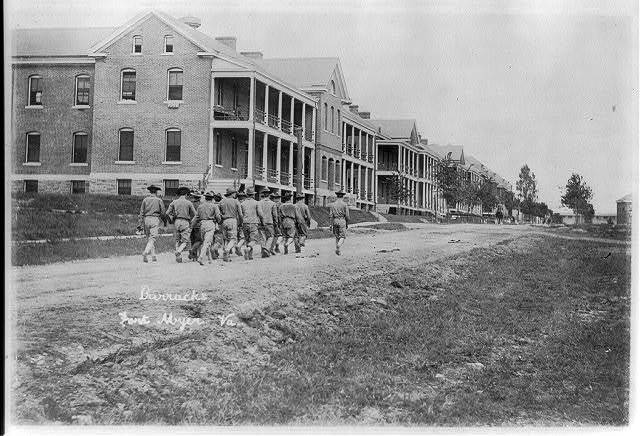 [Squad marching toward barracks, Fort Myer, Virginia]