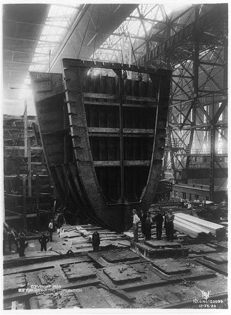 S.S. Nora. View showing 40 ton forward web frame, collision bulkhead and chain locker being put into place by cranes