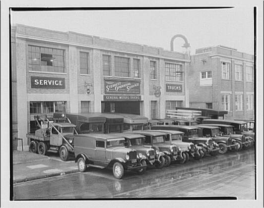 Sterret Operating Service. Building and trucks in front of Sterret Operating Service