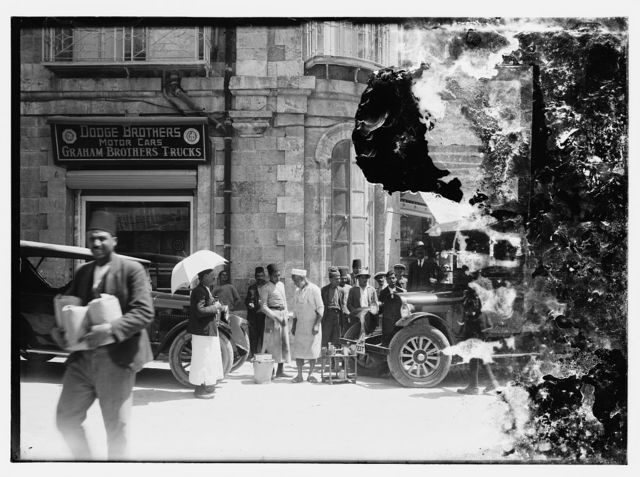 Street scene looking toward store front of Dodge Brothers Motor Cars/Graham Brothers Trucks