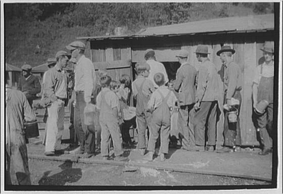Striking miners drawing rations, West Virginia. Miners ration line III