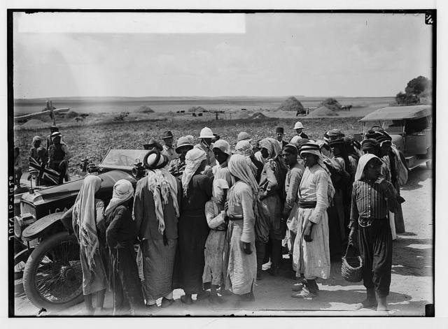 The new era in Palestine. The arrival of Sir Herbert Samuel, H.B.M. high commissioner, etc. Sir Herbert Samuel, talking to the peasants.