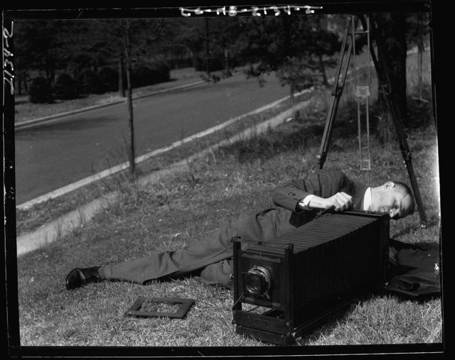 Theodor Horydczak. Theodor Horydczak lying on ground with camera II