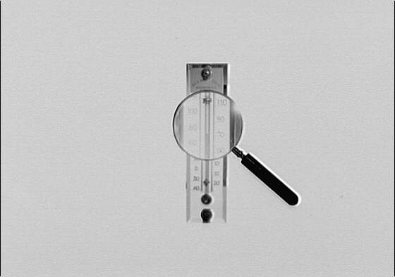 Thermometer and magnifying glass. Setup of thermometer and magnifying glass