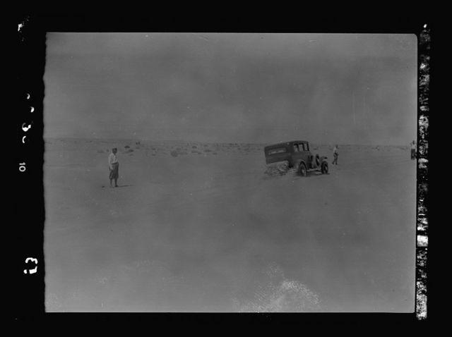 To Sinai by car. Car rushing a sand dune near Bir Hassana